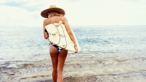 sexy woman with purse in beach