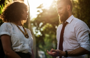 man talking to woman outside