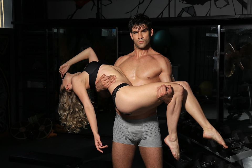 Man holding sexy woman